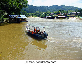 Tourist boat on Tembeling river, Taman Negara National Park,...