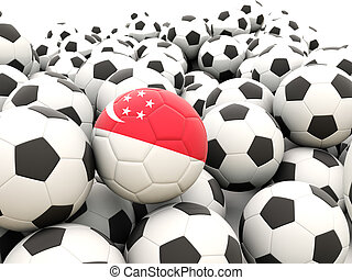 Football with flag of singapore in front of regular balls