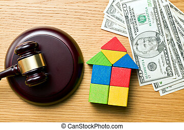 wooden house with money and judge gavel - the wooden house...