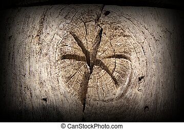 interesting star in wood knot, section on an old oak beam