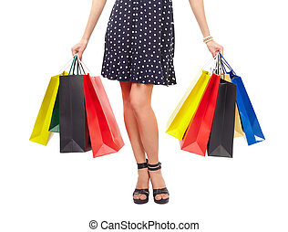 Waist-down view of woman with shopping bags - Waist-down...