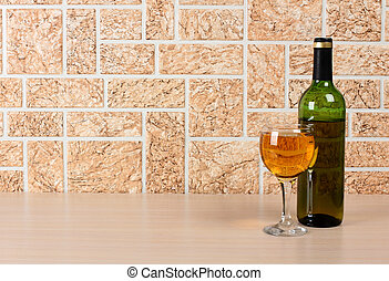 Wineglass on brick background - Wine bottle and glass on...