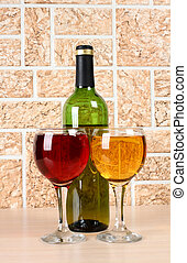 Wineglass on stone background - Wine bottle and glass on...