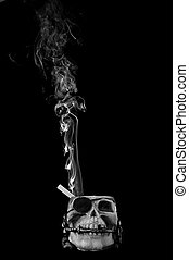 smoking kills concept. Cigarette in skull ashtray.