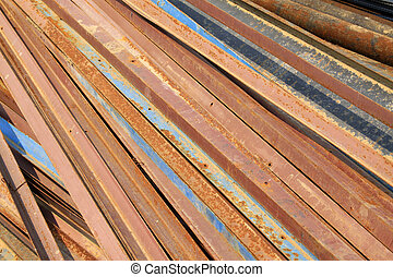 oxidation rusty angle iron piling up in together