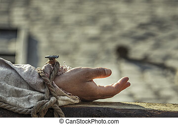 Nailed hand on wooden cross - Hand nailed on wooden as...