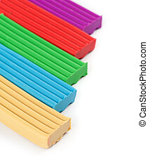 pieces of colored plasticine on a white background