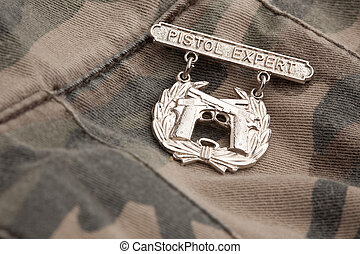 Pistol Expert War Medal on a Camouflage Background.