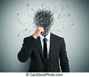 Confused businessman with arrows and lines in head