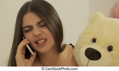 Wicked girl talking on the phone Teddy toy