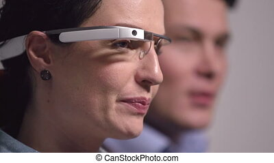 Cutting Edge Technology - Businesswoman wearing google glass...