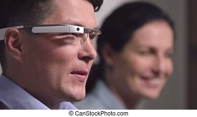Concepts and Ideas - Man with google glasses speaking, woman...