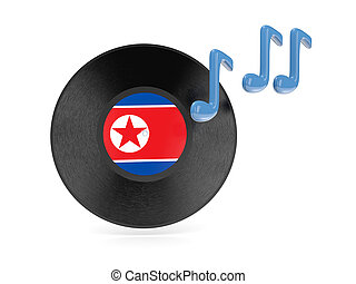 Vinyl disk with flag of north korea isolated on white