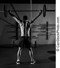 barbell weight lifting man rear view workout gym - barbell...