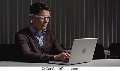Google Goggles - Businessman sitting alone at the desk...