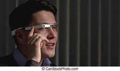Ubiquitous Computing - Close up of man using smart glasses...