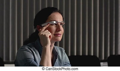 New Device - Woman at the office swiping side of goggle...