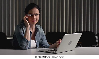 Increasing Productivity - Businesswoman at the desk using...