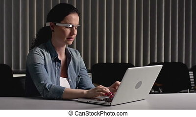 Fresh Gadget - Business lady pressing buttons on notebook...