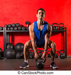 Kettlebell workout training man at gym - Kettlebell swing...