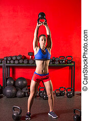 Kettlebell swing workout training woman at gym with red...
