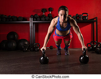 Kettlebells push-up woman strength gym workout - Kettlebells...
