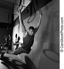 Muscle ups rings man swinging workout at gym - Muscle ups...