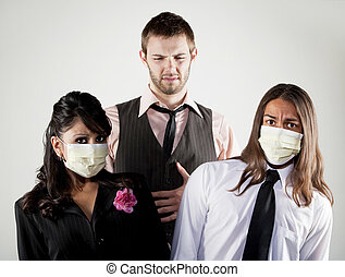 Sick man and worried coworkers in masks