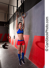 Muscle ups rings woman workout at gym