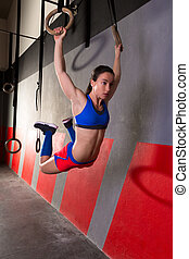 Muscle ups rings woman swing workout at gym