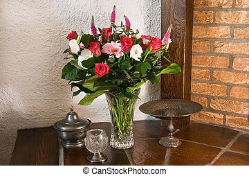 Classic stillife and vase with flowers in red, white and...