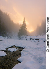 Winter foggy sunset on ice mountains river - Winter foggy...