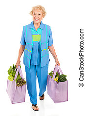 Environmentally Aware Senior Shopper - Beautiful senior lady...