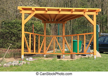 Wooden pergola painted yellow glazing, built in the garden...
