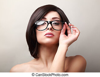 Sexy success woman in glasses looking