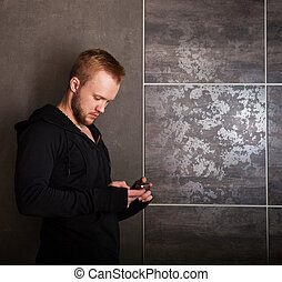 Casual man with touch screen phone