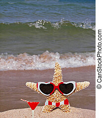 Christmas Party - Starfish on beach with drink, sunglasses...