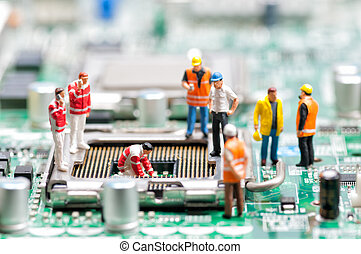 Team of engineers repairing circuit board. Computer repair...