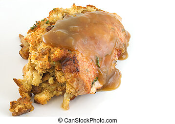 Stuffed pork chop covered in gravy