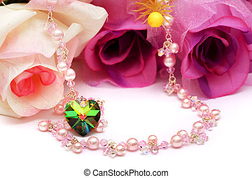 Necklace - A heart shape bead and pink necklace put with...