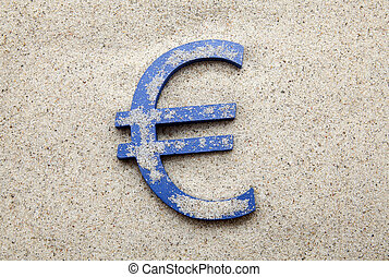 Blue euro symbol in the sand