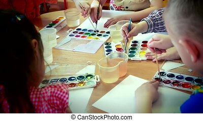 Children draw a watercolor