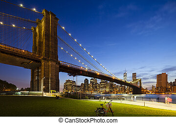 Brooklyn Bridge in New York At Night - The Brooklyn Bridge...