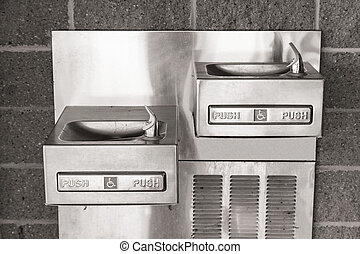 Drinking Fountains - Wall mounted pair of shining metal...