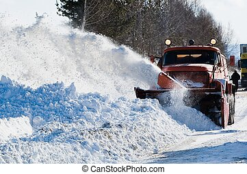 Snowplow at snow removing - Snowplow removing snow from...