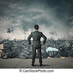 Pollution problem - Businessman against a field full of...
