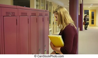 student visits locker - A high school student visits locker....