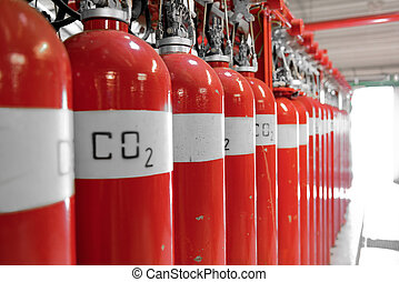 Large CO2 fire extinguishers in a room