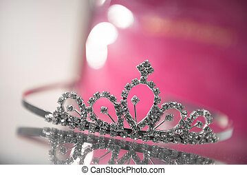Design princess crown on glass cupboard closeup