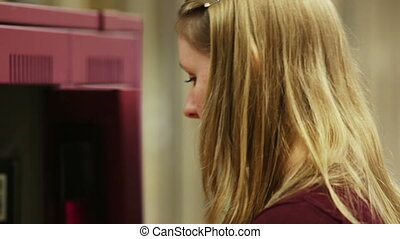 student visits locker - A high school student visits locker...